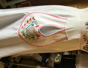 Embroidered pocket with ric rac edging