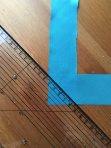 Use a ruler to create a diagonal line for stitching.